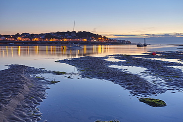A dusk view across the estuary of the River Torridge from Instow, looking towards the lights of Appledore, in north Devon, England, United Kingdom, Europe