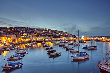 A dusk view of the fishing harbour at Brixham, the south coast's busiest fishing port, in Torbay, on the south coast of Devon, Brixham, Devon, England, United Kingdom, Europe