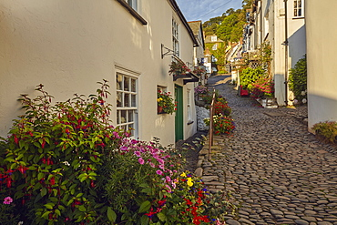 Steep streets and classic cottages at an iconic coastal village, Clovelly, on Devon's north coast, Devon, England, United Kingdom, Europe