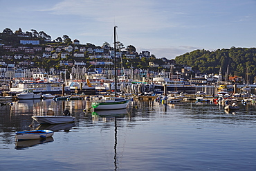 A crowd of boats moored in the harbour in the estuary of the River Dart, at Dartmouth, on the south coast of Devon, England, United Kingdom, Europe