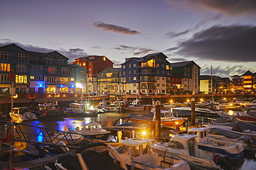 A dusk view of the marina and modern apartments in the revamped dock at Exmouth, on the south coast of Devon, England, United Kingdom, Europe