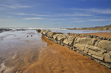 The dramatic mixed sand and rocks of the beach at Speke's Mill Mouth, on Devon's Atlantic coast, near Hartland Quay, Devon, England, United Kingdom, Europe