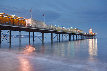 A dusk view of a classic seaside pier, Paignton Pier, Torbay, Devon, England, United Kingdom, Europe