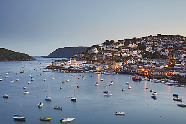 An atmospheric dusk view across the village of Salcombe and the Kingsbridge estuary, on Devon's south coast, Devon, England, United Kingdom, Europe
