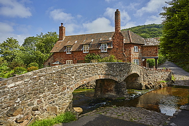 The packhorse bridge and old cottages in the village of Allerford, Exmoor National Park, Somerset, England, United Kingdom, Europe
