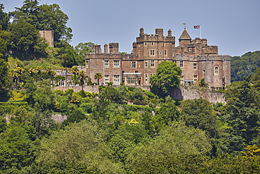 The historic Dunster Castle, on the edge of the village of Dunster, Exmoor National Park, Somerset, England, United Kingdom, Europe