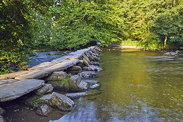 The prehistoric slab stone bridge, Tarr Steps, crossing the River Barle, near Dulverton, in Exmoor National Park, Somerset, England, United Kingdom, Europe