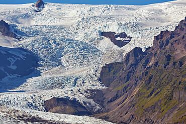 A spectacular glacier pouring down off the Vatnajokull icecap, Svinafellsjokull Glacier, Skaftafell National Park, Iceland, Polar Regions