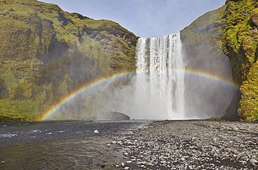 A permanent rainbow in waterfall spray, Skogafoss Falls, near Vik, southern Iceland, Polar Regions