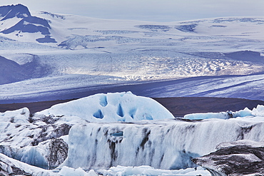 A retreating glacier, pouring down from the Vatnajokull icecap, in Skaftafell National Park, southern Iceland, Polar Regions