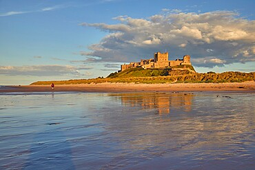 Bamburgh Castle and its beach, at Bamburgh, near Seahouses, Northumberland, England, United Kingdom, Europe