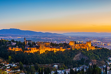 View of Alhambra, UNESCO World Heritage Site, and Sierra Nevada mountains at dusk, Granada, Andalucia, Spain, Europe