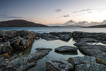 Bagh a Deas (South Beach), with Sandray, Pabbay, Mingulay and Berneray in far distance at sunset, Vatersay, Outer Hebrides, Scotland, United Kingdom, Europe