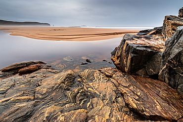 Rock formations at Sandwood Bay, with Am Buachaille sea stack in far distance, Sutherland, Scotland, United Kingdom, Europe - 1209-201