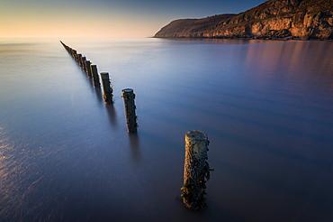 Groynes, Brean Beach, with Brean Down in far distance, Somerset, England, United Kingdom, Europe