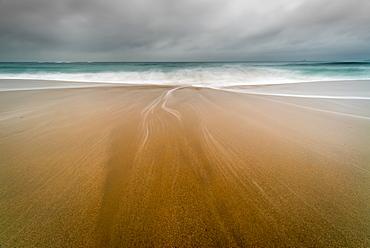 Water trails on Sennen Beach, with Brissons in far distance, Sennen, Cornwall, England, United Kingdom, Europe