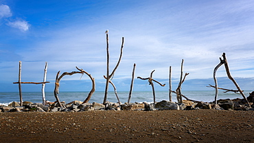 Hokitika coast and sign made of drift wood, Hokitika, West Coast of South Island, New Zealand, Pacific