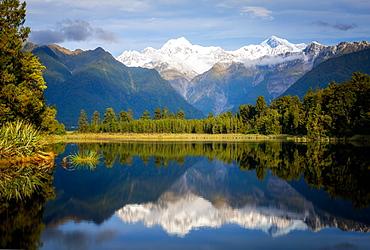 Mount Tasman and Aoraki (Mount Cook) reflected in Lake Matheson, South Island, New Zealand, Pacific