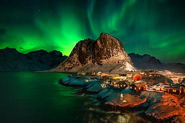 Aurora Borealis (Northern Lights) above Rorbuer fishermen's huts, Hamnoy, Moskenesoya, Lofoten Islands, Nordland, Norway, Europe