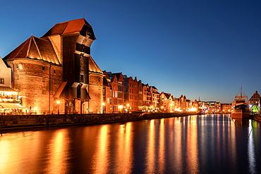 Medieval Port Crane Zuraw at twilight, Motlawa River, Gdansk, Poland, Europe