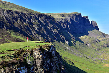 Tourists enjoying the beautiful views of the Quiraing, Isle of Skye, Scotland, United Kingdom
