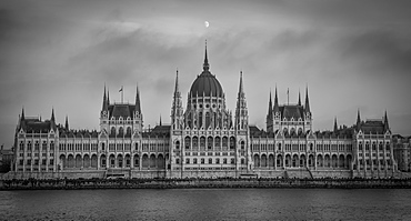 Hungarian Parliament with the moon above in black and white, Budapest, Hungary, Europe