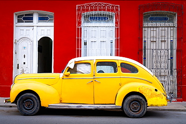Old classic yellow car, Cienfuegos, Cuba, West Indies, Caribbean, Central America