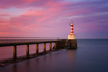 South Pier Lighthouse at sunset, Amble, Northumberland, England, United Kingdom, Europe
