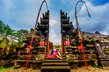 Woman posing for photo at the Besakih Temple, the largest and holiest temple of Hindu religion in Bali, Indonesia, Southeast Asia, Asia