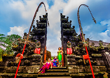 Women posing for photo at the Besakih Temple, the largest and holiest temple of Hindu religion in Bali, Indonesia, Southeast Asia, Asia