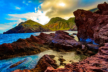 Rocky island mountains meet the beautiful blue of the ocean on Saba Island, Netherlands Antilles, West Indies, Caribbean, Central America