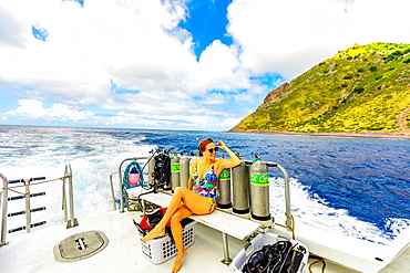 Woman taking in the sights from a boat on the water on Saba Island, Netherlands Antilles, West Indies, Caribbean, Central America