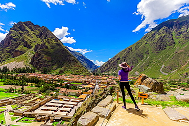 Woman looking out over the city of Ollantaytambo, Peru, South America