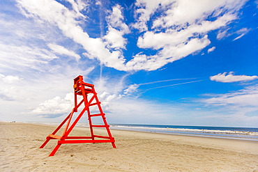 Empty lifeguard chair on empty Jacksonville beach during closing hours during Covid-19 pandemic, Florida, United States of America, North America
