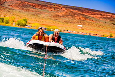 Two friends tubing in Utah, United States of America, North America