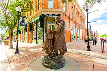 A statue of a Sioux Native American woman and her daughter in downtown Rapid City, South Dakota, United States of America, North America