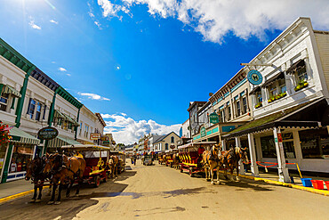 Horse and carriage filled streets lined with beautiful colorful buildings, Mackinac Island, Michigan, United States of America, North America