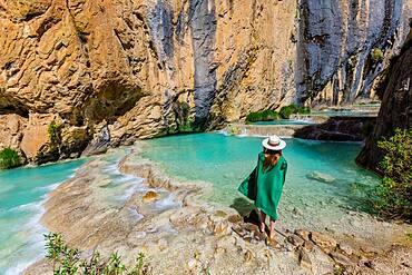 Woman taking in the Millpu Natural Pools, Ayacucho, Peru, South America