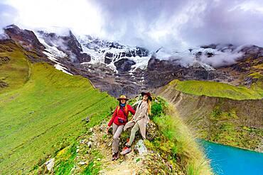 Two women trekking Humantay Lake, Cusco, Peru, South America