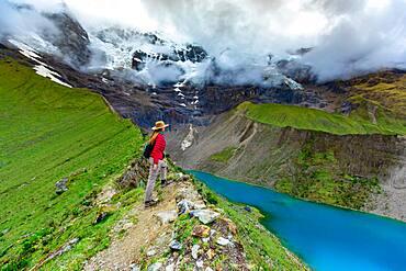 Woman trekking Humantay Lake, Cusco, Peru, South America