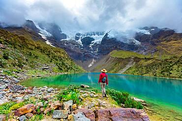 Woman enjoying the cloudy view of Humantay Lake, Cusco, Peru, South America