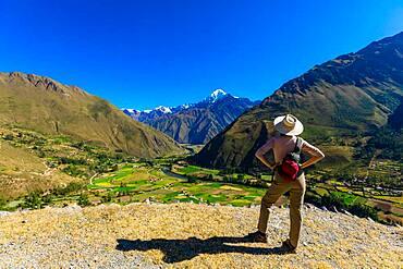 Woman exploring Inti Punku (Sun Gate), Cusco, Peru, South America