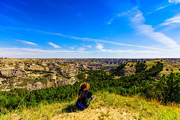 Woman enjoying the view along the Theodore Roosevelt National Park North Unit.