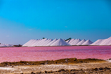 View of the pink colored ocean overlooking the Salt Pyramids of Bonaire from afar.