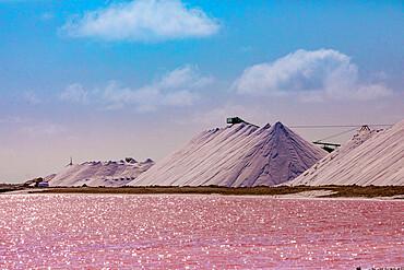 Pink colored ocean overlooking the Salt Pyramids of Bonaire.