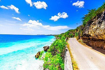 Crystal clear blue ocean side driving along the road on Bonaire.