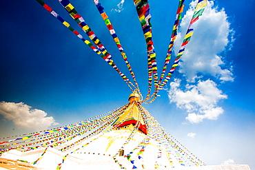 Prayer flags and Buddhist stupa at Bouddha (Boudhanath), UNESCO World Heritage Site, Kathmandu, Nepal, Asia