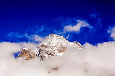 Peak of Mount Everest peeking through the clouds, Sagarmartha National Park, UNESCO World Heritage Site, Himalayas, Nepal, Asia