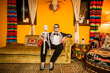 Man in Dia de los Muertos makeup and costume, Day of the Dead celebration in the desert, California, United States of America, North America