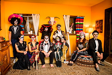 Group of friends in Dia de los Muertos makeup and costume, Day of the Dead celebration in the desert, California, United States of America, North America